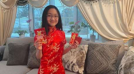 Elaine Ma, 10, of Sayville, shows some of