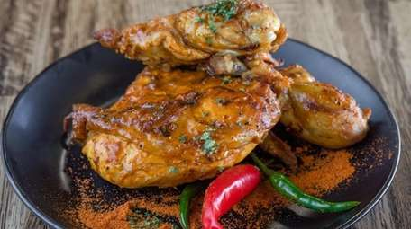 Peri-peri chicken, the signature offering at Peri-Peri Guys,
