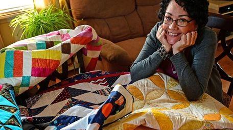 Nivia E. Maldonado displays quilts in her Levittown