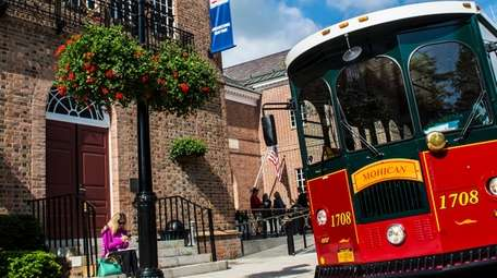 A trolley pulls up to the National Baseball
