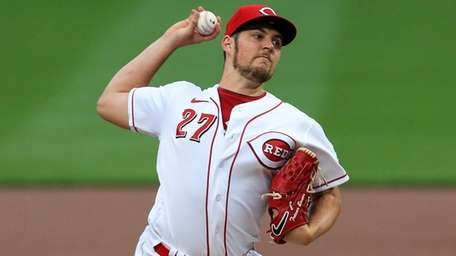 The Reds' Trevor Bauer winds up during the
