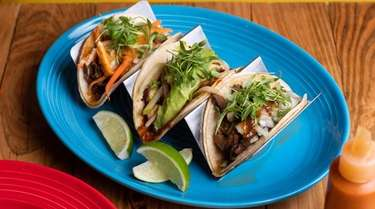 Barbacoa, octopus and portabello mushroom tacos served at