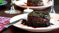 Filet mignon steaks with savory balsamic caramel sauce.