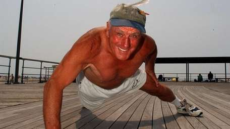 Jones, at age 76, does a one-arm pushup