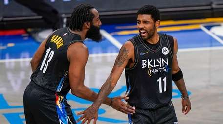 Nets guard Kyrie Irving celebrates with guard James