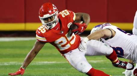 Clyde Edwards-Helaire of Kansas City is tackled by