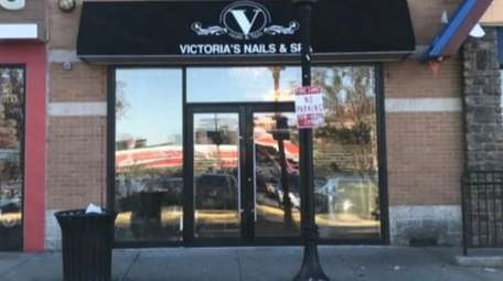 The owners of Victoria's Nails & Spa, with