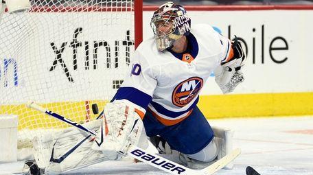 Islanders goaltender Semyon Varlamov is unable to make