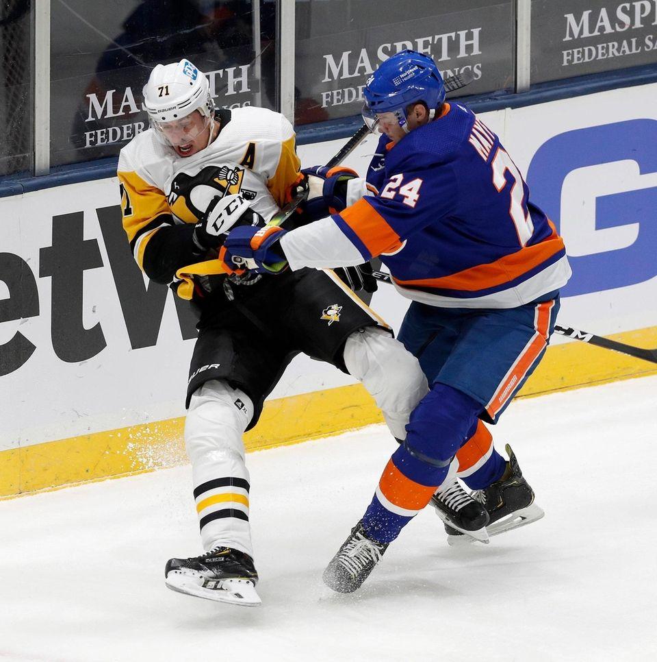 Scott Mayfield of the New York Islanders checks