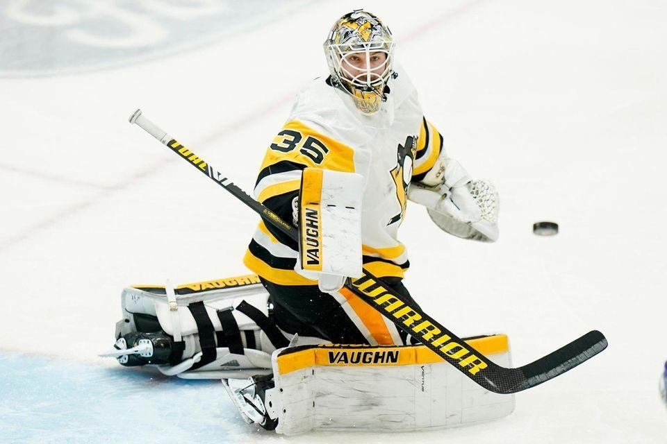 Pittsburgh Penguins goaltender Tristan Jarry (35) deflects a