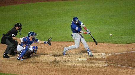 Chicago Cubs centerfielder Albert Almora Jr. hits a