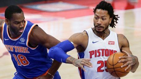 Detroit Pistons guard Derrick Rose (25) drives to