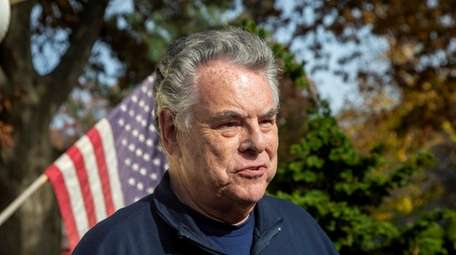 Congressman Peter King speak outside his home on