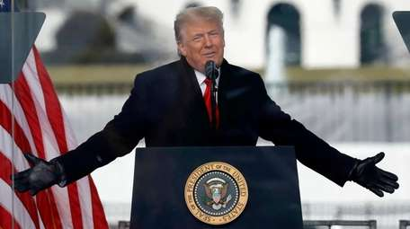 Former President Donald Trump addresses supporters near the