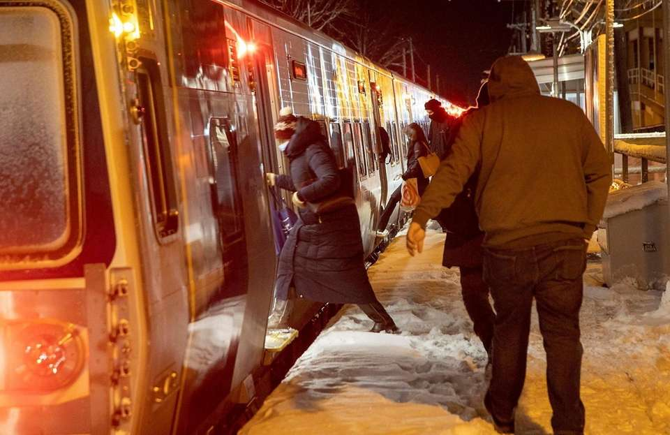 Commuters still deal with a snow covered platform