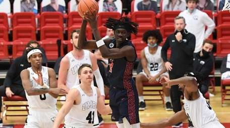 Stony Brook forward Mouhamadou Gueye spins to the