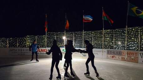 Skaters circle the ice rink during a teen