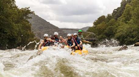 Rafters ride the rapids on the New River,