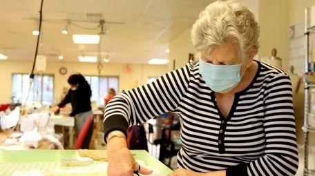 Jo Ann Hunt cuts a piece of fabric