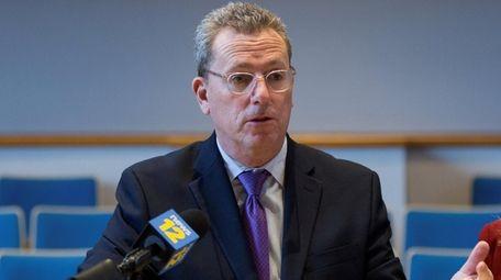 Huntington Town Board member Mark Cuthbertson speaks at