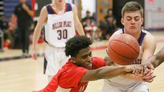 Amityville's Caleb Figgs Stallings (3) and Miller Place's