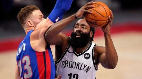 Nets guard James Harden is defended by Pistons