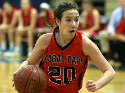 Floral Park's Erin Harkins looks to drive against
