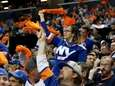 Fans cheer during the first period of the