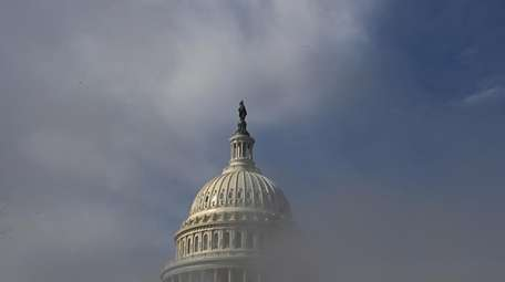 The dome of the U.S. Capitol is obscured