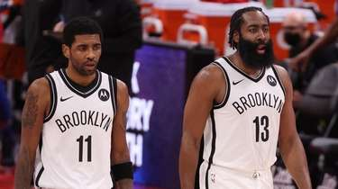 Kyrie Irving #11 and James Harden #13 of