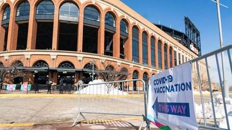 People wait for COVID-19 vaccinations at Citi Field
