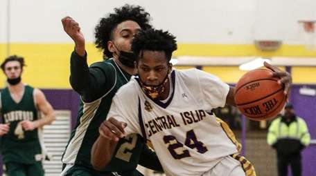 Jaiden Butts of Central Islip drives to the
