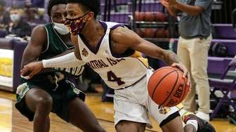 Isiah Sween of Central Islip works the baseline