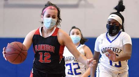 Emily Tierney #12 of Plainedge, left, drives to