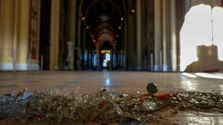 Broken glass and debris littered the U.S. Capitol