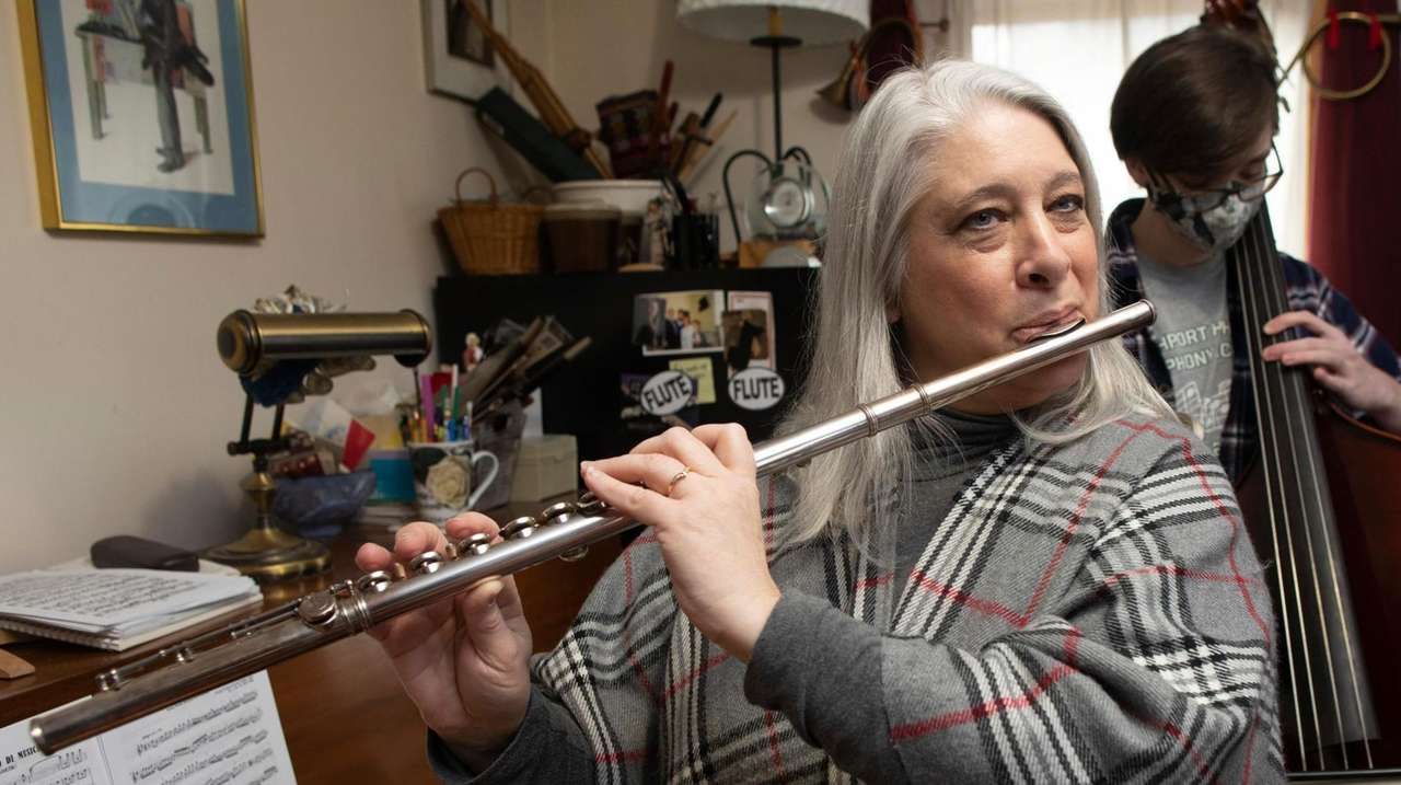 Deborah Sherman of East Northport, practices along with