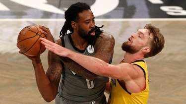 DeAndre Jordan of the Nets controls the ball