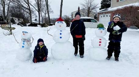 Neighborhood cheer was the idea behind the snowmen
