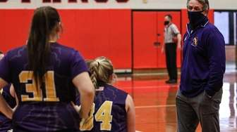 Sayville head coach Phil DePompeo talks to his