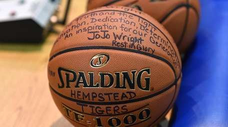 The Hempstead boys basketball team pays tribute to
