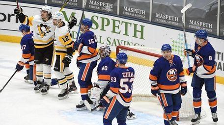 Penguins center Zach Aston-Reese celebrates his goal with