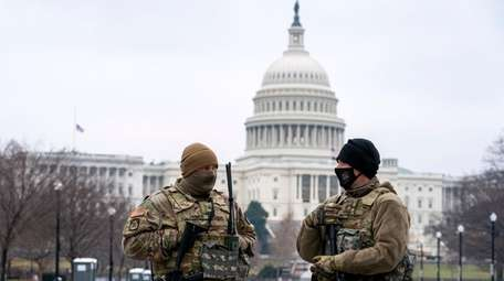National Guard troops patrol the U.S. Capitol grounds