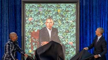 The portraits of President Barack Obama and Mrs.