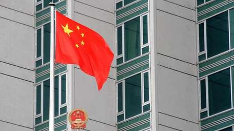 The Chinese flag flies outside the People's Republic