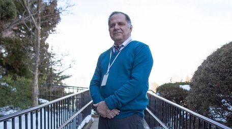 Garden City teacher Carlo Rebolino has received his
