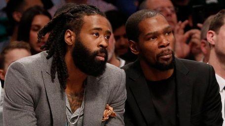 DeAndre Jordan, left, and Kevin Durant of the