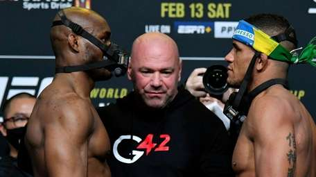 LOpponents Kamaru Usman of Nigeria and Gilbert Burns