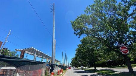Large steel poles beside the Merillon Avenue LIRR
