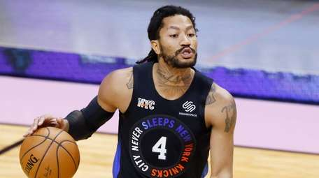 Derrick Rose of the Knicks dribbles against the