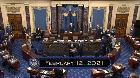 In this image from video, the Senate, sitting